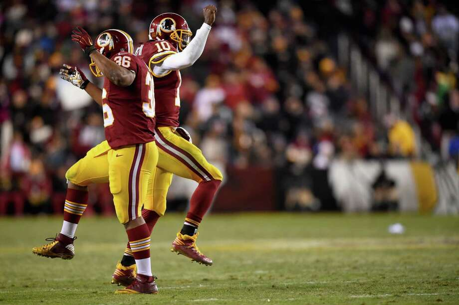 Washington fullback Darrel Young (36) celebrates with Robert Griffin III after scoring a touchdown. Photo: Patrick Smith / Getty Images / 2014 Getty Images