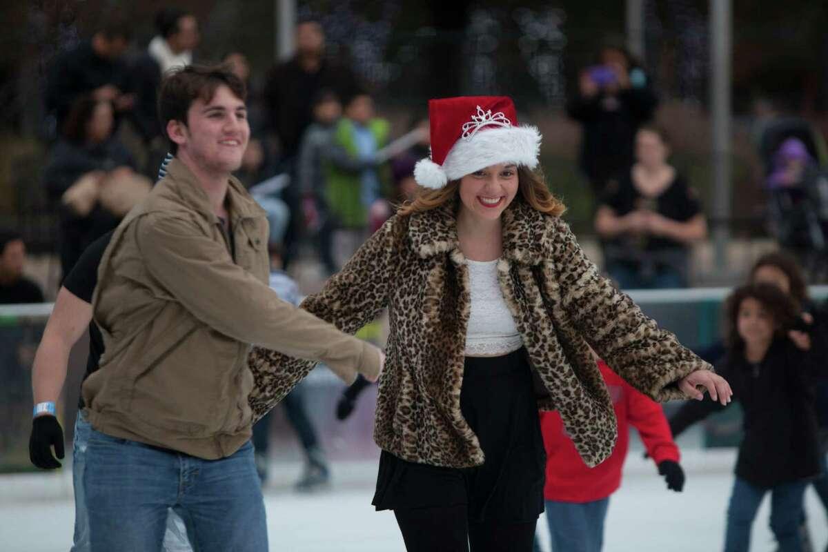 Katherine Alaniz, 18, skates with her boyfriend Daniel Bonn, 18, at Discovery Green Ice, Saturday, Dec. 20, 2014, in Houston.