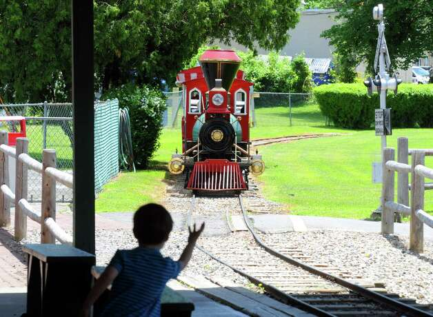 Three-year-old Johnathan Kotyuba of Clifton Park excitingly waves to the approaching train at Hoffman's Playland on Thursday May 29, 2014 in Latham, N.Y. (Michael P. Farrell/Times Union) Photo: Michael P. Farrell