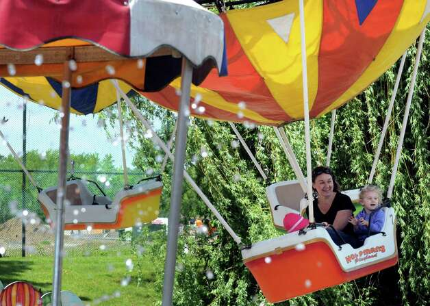 Karah Baj and her 3-year-old daughter Gracie Anderson enjoy the balloon lift ride at Hoffman's Playland on Thursday May 29, 2014 in Latham, N.Y. (Michael P. Farrell/Times Union) Photo: Michael P. Farrell