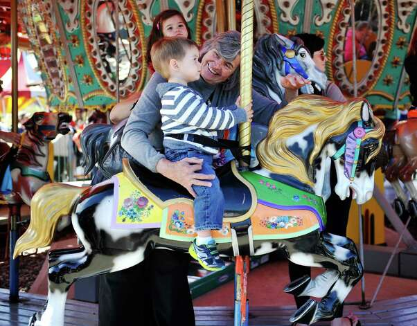 Gloria Knorr of Colonie rides the merry-go-round with her grandson, Nicholas Bolling, 2, of Cohoes during the final day of business at Hoffman's Playland, on Sunday, Sept. 14, 2014, in Latham, N.Y.  Knorr often came to Hoffman's when she was a child.  The business first opened in 1952.  (Paul Buckowski / Times Union) Photo: Paul Buckowski / 00028503A