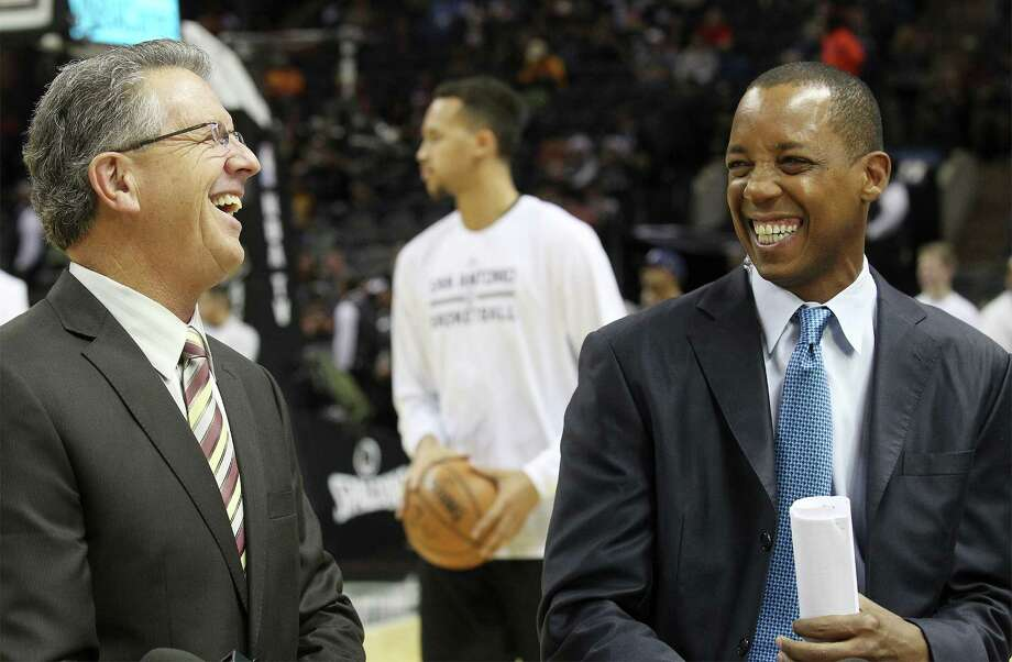 Spurs commentators Bill Land (left) and Sean Elliott share a laugh during a taping of their show at the AT&T Center on Friday, Dec. 12, 2014. Photo: Kin Man Hui /San Antonio Express-News / ©2014 San Antonio Express-News