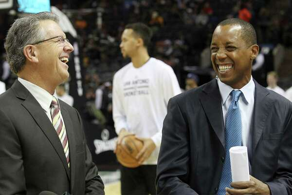 Spurs commentators Bill Land (left) and Sean Elliott share a laugh during a taping of their show at the AT&T Center on Friday, Dec. 12, 2014.