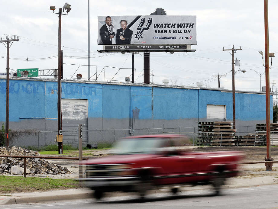 Detail photo of billboard with Sean Elliott and Bill Land Sunday Dec. 14, 2014. Photo: Edward A. Ornelas, Staff / San Antonio Express-News / © 2014 San Antonio Express-News