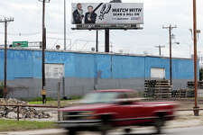Detail photo of billboard with Sean Elliott and Bill Land Sunday Dec. 14, 2014.