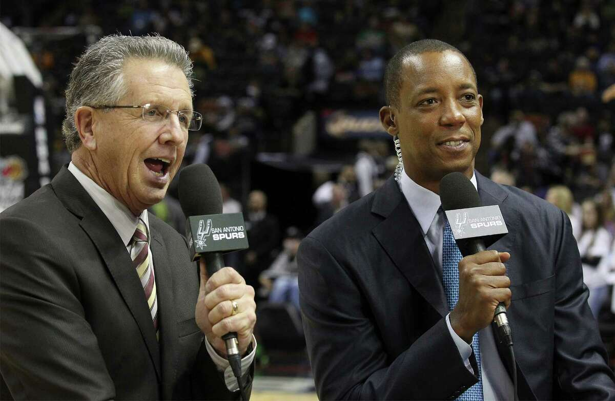 Spurs commentators Bill Land (left) and Sean Elliott work on a tape of their show at the AT&T Center on Friday, Dec. 12, 2014.