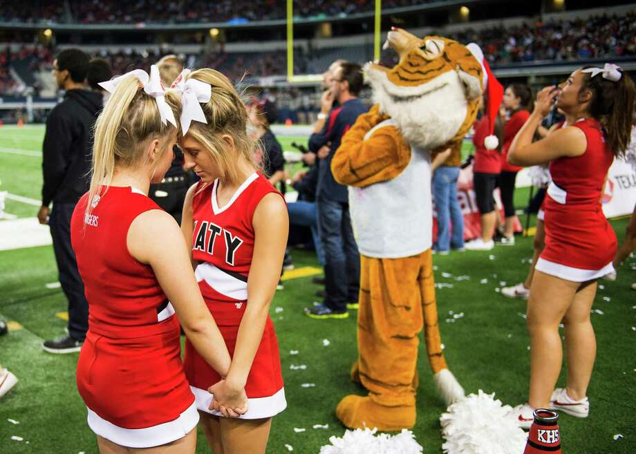 Katy cheerleaders join hands with the game tied in the final minute of a loss to Cedar Hill in the Class 6A Division II state football title game at AT&T Stadium Saturday, Dec. 20, 2014, in Arlington. Photo: Smiley N. Pool, Houston Chronicle / © 2014  Houston Chronicle