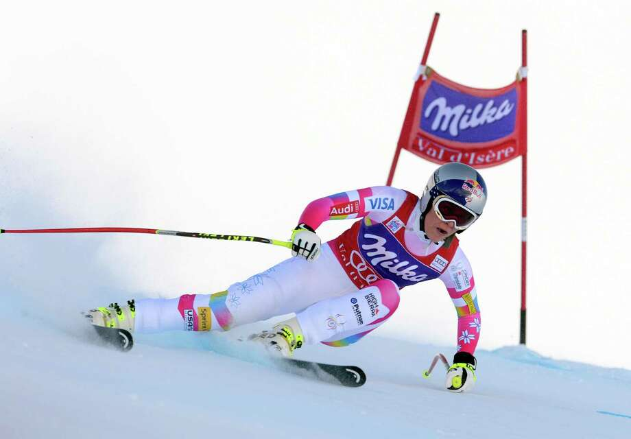 Lindsey Vonn of the United States speeds on her wat to win an alpine ski, women's  World Cup Downhill in Val d'Isere, France, Saturday, Dec. 20, 2014. (AP Photo/Pier Marco Tacca) ORG XMIT: ISE116 Photo: Pier Marco Tacca / AP