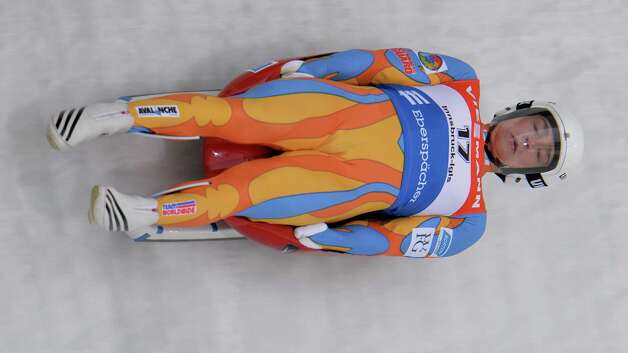 US Tucker West, from Ridgefield Conn. ,  speeds down the course during his first  run  at the Men's luge World Cup race in IIgls,  near Innsbruck Austria, on Saturday, Nov. 23, 2013. (AP Photo/Kerstin Joensson) ORG XMIT: XKJ125 Photo: Kerstin Joensson / AP