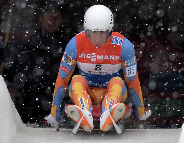 Tucker West of the USA  starts  during the men's  luge World Cup race in Winterberg, Germany, Saturday, Nov. 30, 2013.  (AP Photo/Martin Meissner) ORG XMIT: MME125 Photo: Martin Meissner / AP