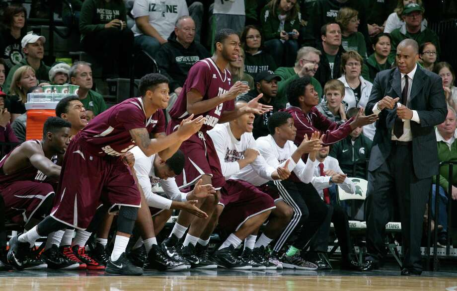 TSU, seen here celebrating an early season upset of Michigan State on the road, clinched a SWAC title on Thursday night. (AP Photo/Al Goldis) Photo: Al Goldis, Associated Press / FR11125 AP