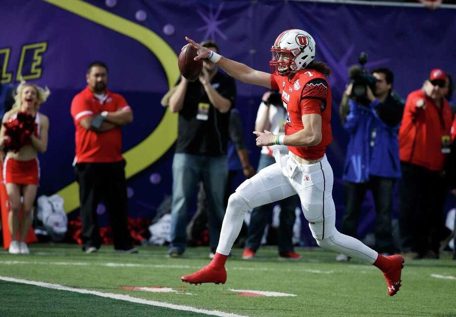 Utah quarterback Travis Wilson runs for a touchdown against Colorado State during the first half of the Las Vegas Bowl NCAA college football game Saturday, Dec. 20, 2014, in Las Vegas. (AP Photo/John Locher) ORG XMIT: NVJL104 Photo: John Locher / AP