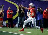 Utah quarterback Travis Wilson runs for a touchdown against Colorado State during the first half of the Las Vegas Bowl NCAA college football game Saturday, Dec. 20, 2014, in Las Vegas. (AP Photo/John Locher) ORG XMIT: NVJL104