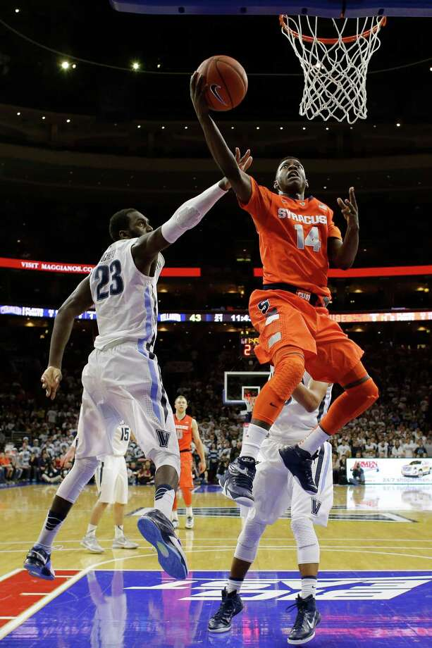 Syracuse's Kaleb Joseph (14) goes up for a shot against Villanova's Daniel Ochefu (23) during the second half of an NCAA college basketball game, Saturday, Dec. 20, 2014, in Philadelphia. Villanova won 82-77 in overtime. (AP Photo/Matt Slocum) ORG XMIT: PXC119 Photo: Matt Slocum / AP