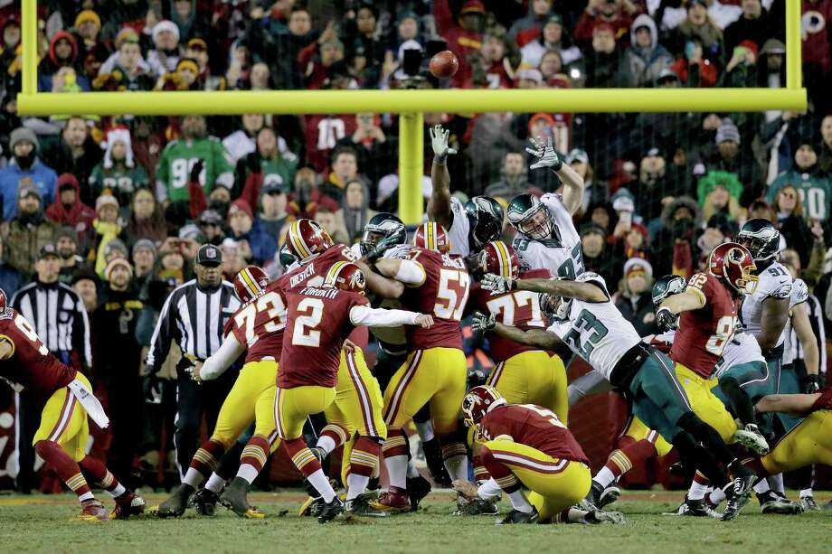 Washington Redskins kicker Kai Forbath (2) boots a field goal during the second half of an NFL football game against the Philadelphia Eagles in Landover, Md., Saturday, Dec. 20, 2014, to give the Redskins a 27-24 victory over the Eagles. (AP Photo/Mark Tenally) ORG XMIT: FDX122 Photo: Mark Tenally / FR170908 AP