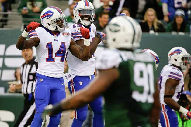 Buffalo Bills wide receiver Sammy Watkins (14) celebrates a touchdown with teammate Mike Williams (19) during the second half of an NFL football game against the New York Jets, Sunday, Oct. 26, 2014, in East Rutherford, N.J.  (AP Photo/Seth Wenig) ORG XMIT: ERU134 Photo: Seth Wenig / AP
