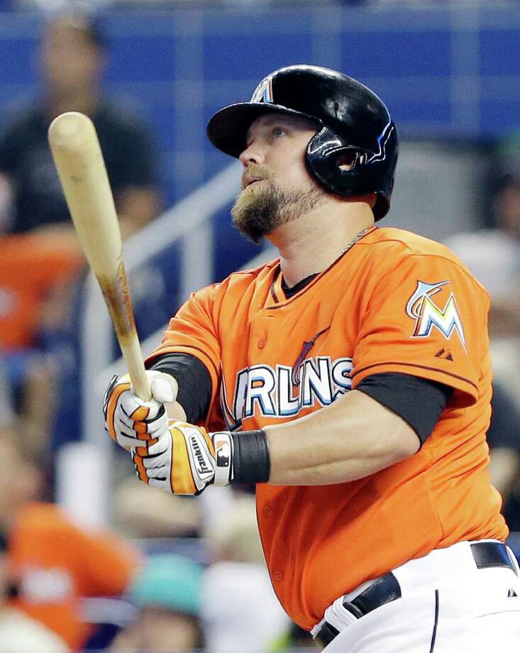 Miami Marlins' Casey McGehee watches the ball after he hit a two-run home run scoring Giancarlo Stanton during the first inning of a baseball game against the San Francisco Giants, Sunday, July 20, 2014 in Miami. (AP Photo/Wilfredo Lee) ORG XMIT: FLWL101 Photo: Wilfredo Lee / AP