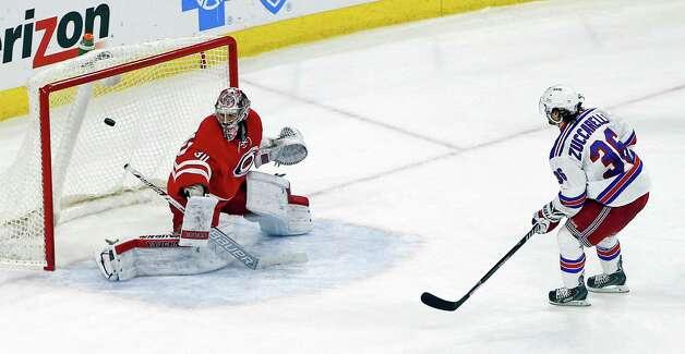 New York Rangers' Mats Zuccarello (36) slips the puck past Carolina Hurricanes goalie Cam Ward (30) to score during a shootout of an NHL hockey game in Raleigh, N.C., Saturday, Dec. 20, 2014. Rangers won 3-2 in a shootout. (AP Photo/Karl B DeBlaker) ORG XMIT: NCKD105 Photo: Karl B DeBlaker / FR7226 AP