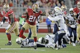 49ers' Frank Gore, 21 stiff arms San Diego's Eric Weddle, 32 en route to a 52 yard first quarter touchdown run, as the San Francisco 49ers take on the San Diego Chargers at Levi's Stadium in Santa Clara, Calif., on Saturday Dec. 20, 2014.