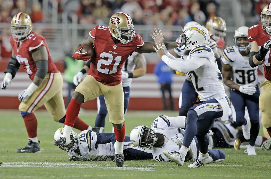 49ers' Frank Gore, 21 stiff arms San Diego's Eric Weddle, 32 en route to a 52 yard first quarter touchdown run, as the San Francisco 49ers take on the San Diego Chargers at Levi's Stadium in Santa Clara, Calif., on Saturday Dec. 20, 2014. Photo: Michael Macor, The Chronicle
