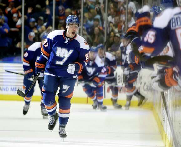 New York Islanders center Anders Lee (27)  celebrates his goal against the Tampa Bay Lightning with teammates in the third period of an NHL hockey game at Nassau Coliseum on Saturday, Dec. 20, 2014, in Uniondale, N.Y. The Islanders won 3-1. (AP Photo/Kathy Kmonicek) ORG XMIT: NYI113 Photo: Kathy Kmonicek / FR170189 AP