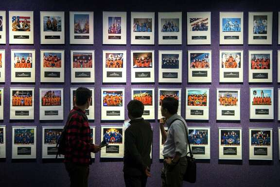 Visitors to Space Center Houston can view photos of astronauts in a gallery that includes all of the space shuttle crews.  In 2001, NASA had nearly 150 astronauts, but as of November, 43 active fliers remain.