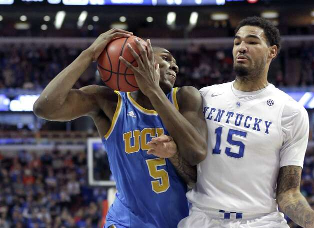 UCLA forward Kevon Looney (5) is pressured by Kentucky forward Willie Cauley-Stein (15) during the first half of an NCAA college basketball game Saturday, Dec. 20, 2014, in Chicago. (AP Photo/Nam Y. Huh) ORG XMIT: ILCA134 Photo: Nam Y. Huh / AP