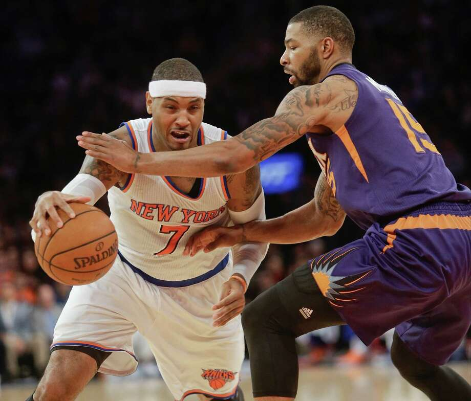 New York Knicks' Carmelo Anthony (7) drives past Phoenix Suns' Marcus Morris (15) during the second half of an NBA basketball game, Saturday, Dec. 20, 2014, in New York. The Suns won the game 99-90. (AP Photo/Frank Franklin II) ORG XMIT: MSG111 Photo: Frank Franklin II / AP