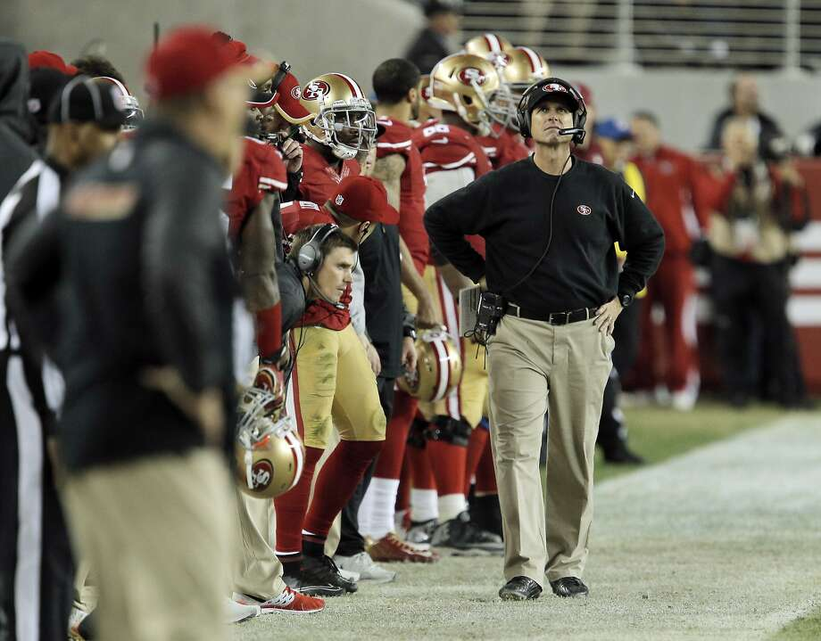 Jim Harbaugh walks along the sidelines during the second half as the 49ers played the San Diego Chargers at Levi's Stadium in Santa Clara, Calif., on Saturday, December 20, 2014. Photo: Carlos Avila Gonzalez, The Chronicle