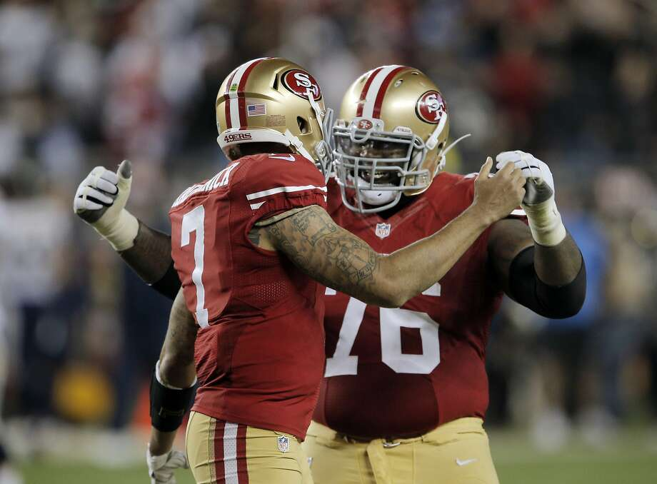 "49ers' right tackle Anthony Davis (left) abruptly left the team in June, citing a need to let his ""brain and body heal."" Photo: Carlos Avila Gonzalez, The Chronicle"