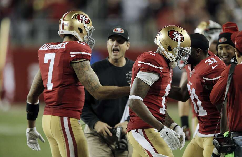 Colin Kaepernick (7) is congratulated as he returns to the sidelines after his 90-yard touchdown run during third quarter as the 49ers played the San Diego Chargers at Levi's Stadium in Santa Clara, Calif., on Saturday, December 20, 2014. The touchdown was the only score for the 49ers in the second half. Photo: Carlos Avila Gonzalez, The Chronicle