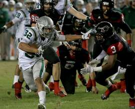 De La Salle's Andrew Hernandez (left) breaks loose during the Spartans' win over Centennial in the Open Division state bowl, the Game of the Year.