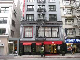 This hotel designed by Oliver and Foulkes opened in 1907 with the entrance at what today is the second floor. But when Stockton Street was lowered a few years later for the Stockton Tunnel, the basement was converted to become the first floor.