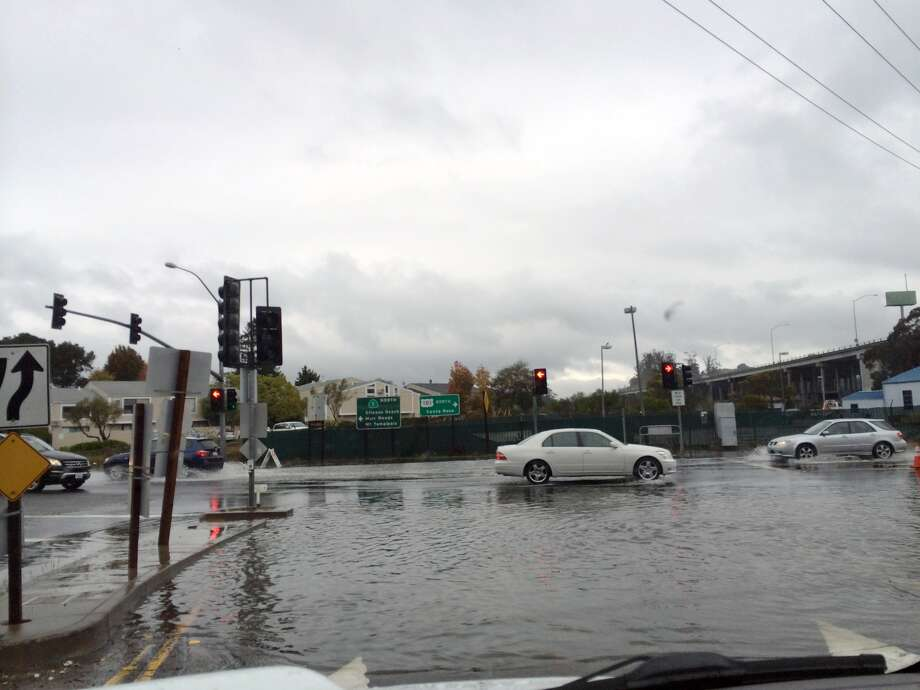 Shoreline Highway in Mill Valley, near the southbound Highway 101 offramp, was flooded on Dec. 2, 2014 during high tides. Photo: Jessica Mullins, The Chronicle