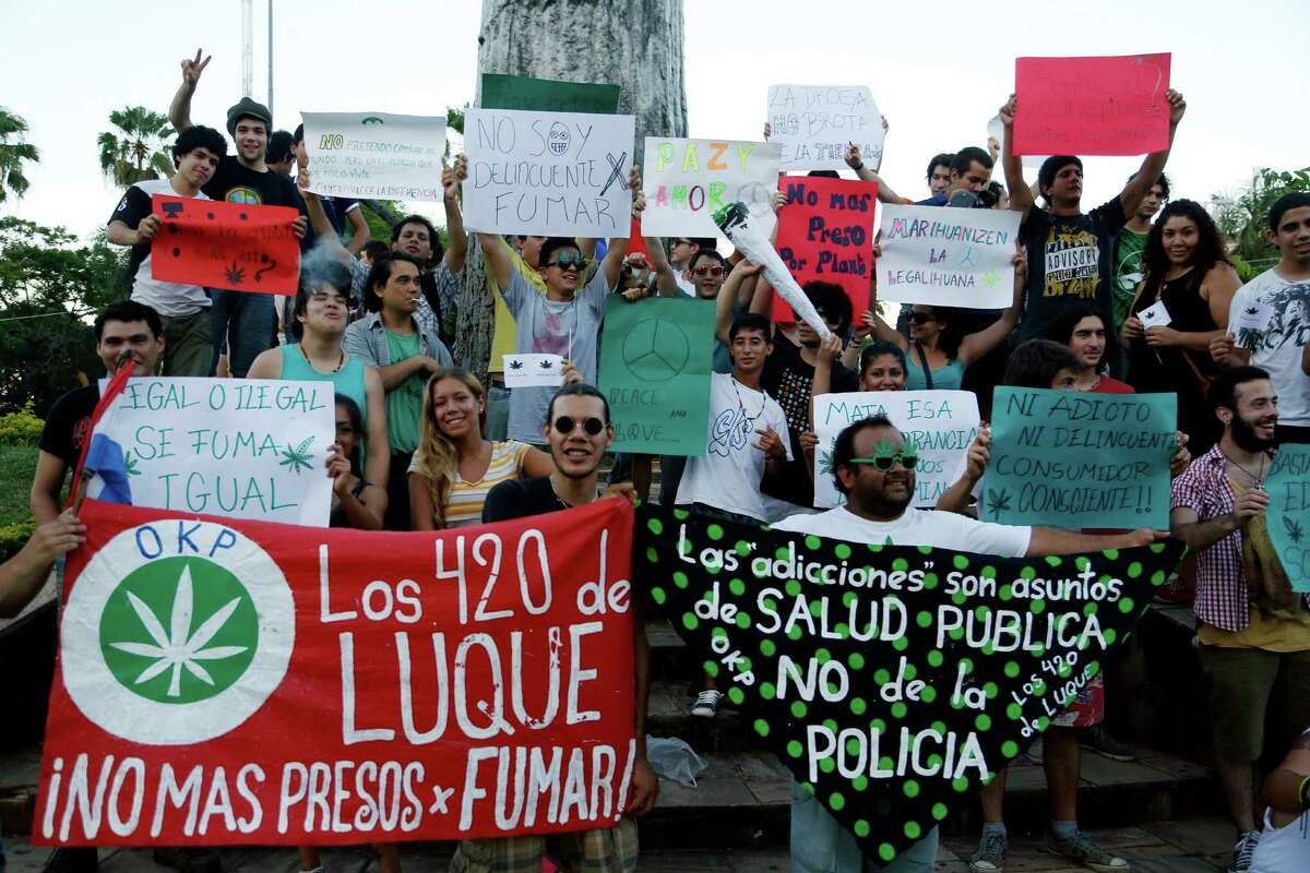 People rally for the legalization of marijuana in Asuncion, Paraguay, Saturday, Dec. 20, 2014. Marijuana is illegal in Paraguay.