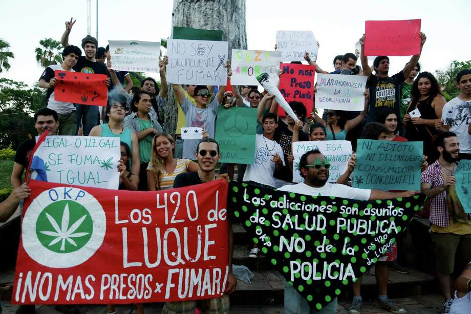 People rally for the legalization of marijuana in Asuncion, Paraguay, Saturday, Dec. 20, 2014. Marijuana is illegal in Paraguay. Photo: Jorge Saenz, AP / AP