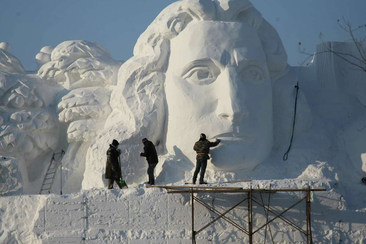 People look at a sculpture prior to the 27th Harbin Sun Island International Snow Sculpture Art Expo on December 20, 2014 in Harbin, China.