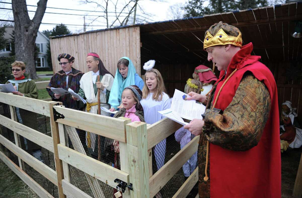 Dressed as a king, Fred Laffan, of Greenwich, sings with others during a live nativity at First Congregational Church in Old Greenwich, Conn. Sunday, Dec. 21, 2014. Church members dressed as Mary, Joseph, kings and shepherds, complete with live sheep as they sang Christmas carols before a small audience outside the church.