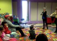 Clare Elena Semes (left) and Chelsea Starbuck Smith (right) play violin at the Children's concert at Danbury Library.