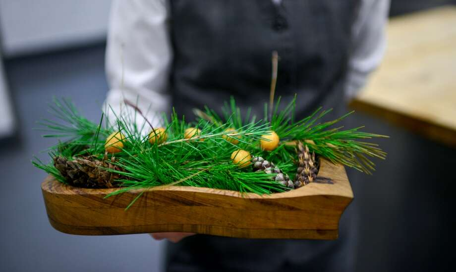 Canapé: Ginko Nut Panko, pine syrup, orange salt.  (Lee)  Notes: The ginko nuts were threaded with long pine needles, breaded in panko, fried, and then dipped in pine syrup, finished with orange zest salt. Photo: Bonjwing Lee Photography
