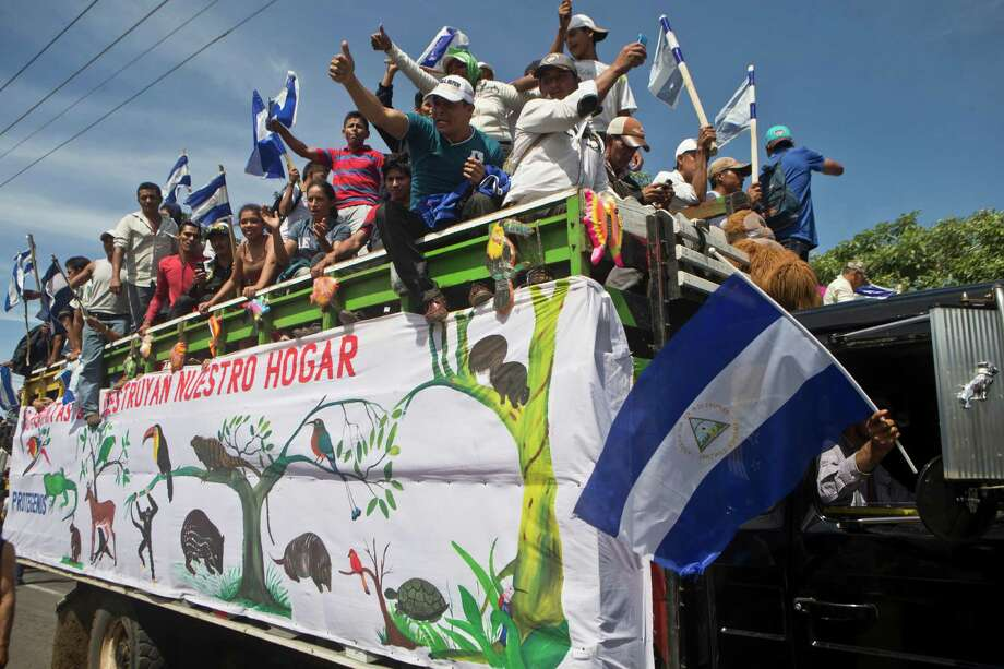 Farmers protest the construction of the $50 billion transoceanic waterway at a march in Managua, Nicaragua. The canal is expected to displace 29,000 people. Photo: Esteban Felix / Associated Press / AP