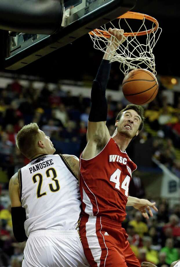 Frank Kaminsky came back for his senior year for moments like this — a dunk over Wisconsin-Milwaukee's J.J. Panoske before a raucous college crowd. Photo: Morry Gash / Associated Press / AP