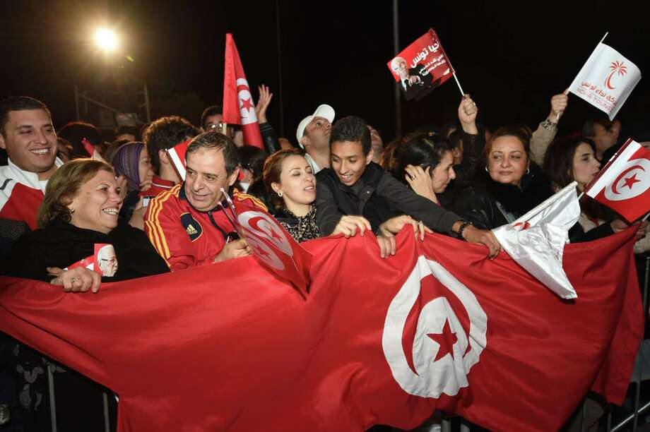 Supporters of presidential candidate Beji Caid Essebsi celebrate in Tunis after exit polls showed he led. Photo: FETHI BELAID / AFP/Getty Images / AFP