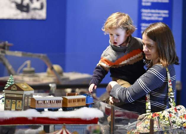 Noah Johnson, 2, enjoys the train display with the aid of his mom, Katie Johnson, at miSci in Schenectady on Friday, Nov. 28, 2014. (Skip Dickstein/Times Union)