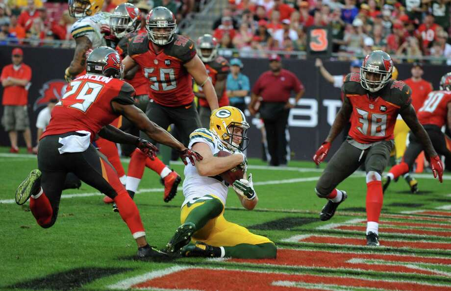 Packers wide receiver Jordy Nelson has a seat in the end zone while scoring a fourth-quarter touchdown. Green Bay clinched a playoff berth with the 20-3 win at Tampa Bay. Photo: Cliff McBride / Getty Images / 2014 Getty Images