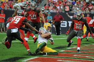 NFL results, Dec. 21: Packers, Lions clinch playoff berths - Photo