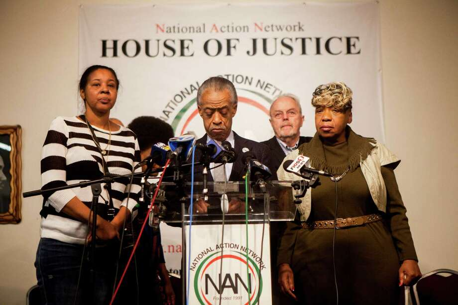 The Rev. Al Sharpton speaks at a news conference with family members of Eric Garner at the headquarters of the National Action Network, a day after two police officers were shot at point-blank range and killed in New York, Dec. 21, 2014. Sharpton denounced the fatal shootings of two city police officers. Authorities said the suspect, who later took his own life, had traveled to New York from Baltimore vowing to kill officers. (Sam Hodgson/The New York Times) Photo: SAM HODGSON / New York Times / NYTNS