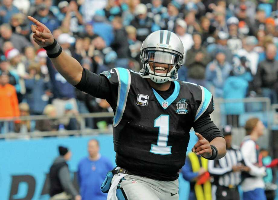 Cam Newton started and won less than two weeks after his back was fractured in two places in an auto accident. Photo: Mike McCarn / Associated Press / FR34342 AP