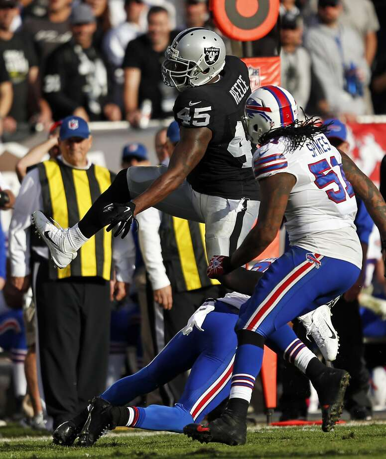 Oakland Raiders' Marcel Reese hurdles Buffalo Bills' Corey Graham in 2nd quarter during NFL game at O.co Coliseum in Oakland, Calif., on Sunday, December 21, 2014. Photo: Scott Strazzante, The Chronicle