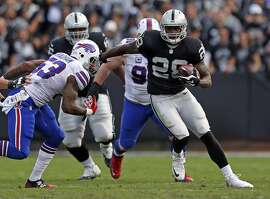 Second-year running back Latavius Murray continued to provide punch for the Raiders rushing game, gaining 86 yards on 23 carries against Nigel Bradham (left) and the Bills defense.